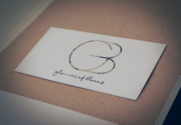 logo for glimmer of blooms
